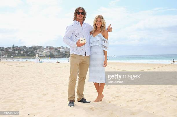 Australian rugby player Nick Cummins poses alongside Erin Holland during The Iconic Summer 2017 Swim Collection Fashion Show at Bondi Beach on...