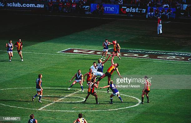 australian rules football match at telstra dome at docklands. - docklands stadium melbourne stock pictures, royalty-free photos & images