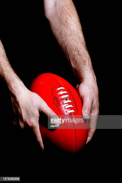 australian rules football - kicking stock pictures, royalty-free photos & images