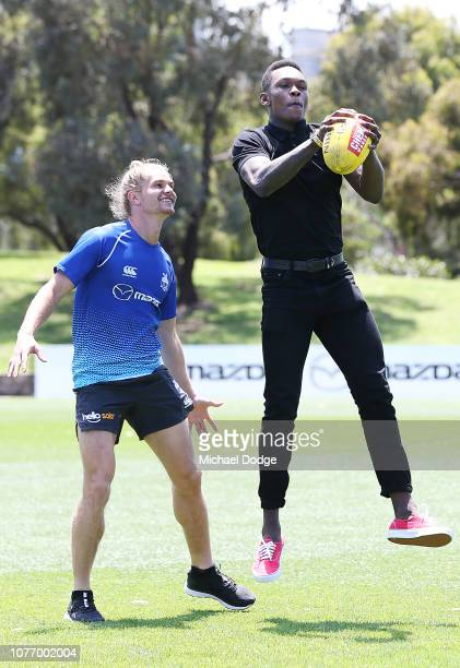 MELBOURNE AUSTRALIA DECEMBER Australian Rules Footballer Jed Anderson of the Kangaroos watches Israel Adesnya of New Zealand mark the ball during a...