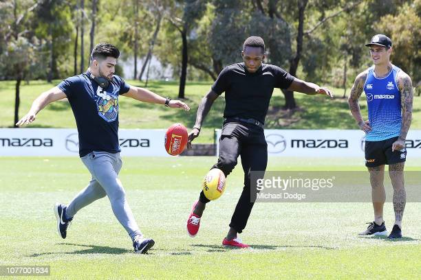 MELBOURNE AUSTRALIA DECEMBER Australian Rules Footballer Marley Williams of the Kangaroos watches Israel Adesnya of New Zealand and UFC fighter...