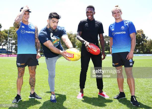 MELBOURNE AUSTRALIA DECEMBER Australian Rules Footballers Jed Anderson and Marley Williams of the Kangaroos pose with UFC fighters Israel Adesnya of...