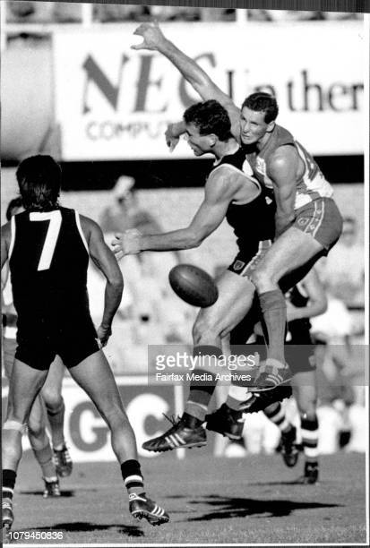 Australian Rules SCGSydney Swans Vs St KildaUp and away Swans' defender Leon Higgins rides high as he punches the ball away from Stewart Loewe St...