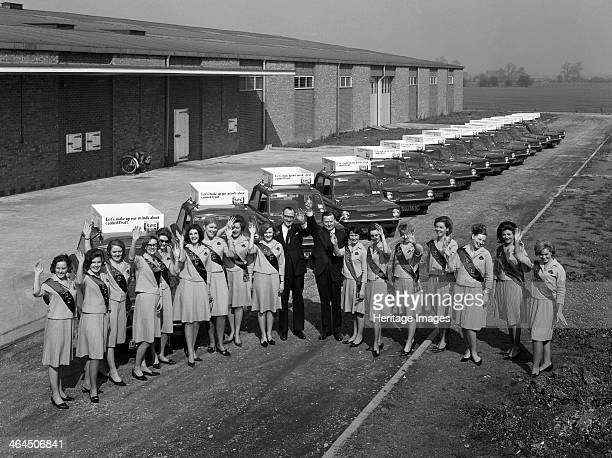 Australian sales girls in front of a fleet of 1965 Hillman Imps Selby North Yorkshire 1965 In a bid to promote the consumption of canned fruit the...