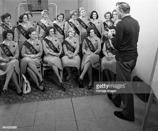 Australian sales girls with SPL sashes listen to a sales talk Selby North Yorkshire 1965 In a bid to promote the consumption of canned fruit the...