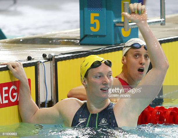 Australian Sarah Ryan celebrates next to Karen Pickering the 2002 Manchester Commonwealth Games women's 4x100m freestyle finals 03 August 2002...