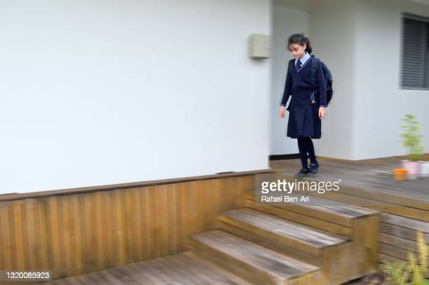 australian school girl leaves home for school in the morning - rafael ben ari fotografías e imágenes de stock