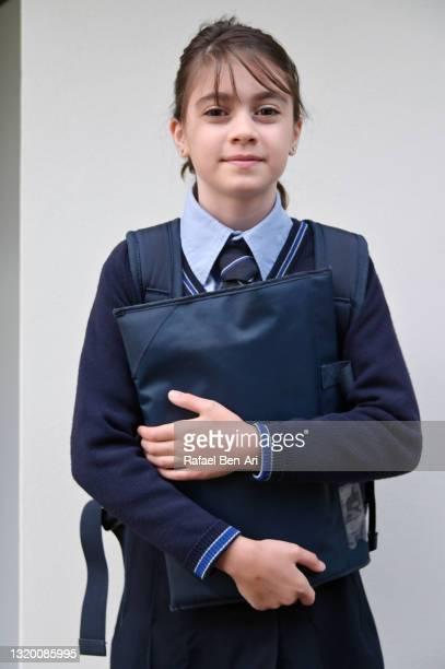 australian school girl wears school uniform - rafael ben ari stock-fotos und bilder
