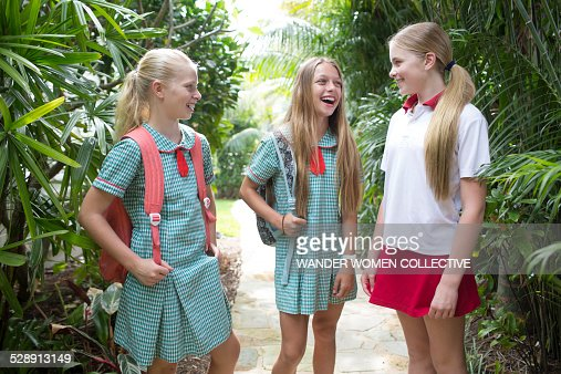 group of teenage friends laughing