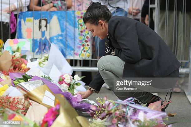 Australian Senator Jaqui Lambie lays flowers on the floral tribute at Martin Place on December 18 2014 in Sydney Australia Sydney siege gunman Man...