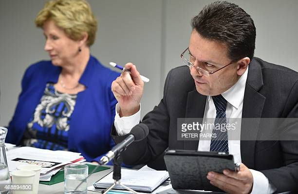 Australian Senator Nick Xenophon grills executives from Apple Google and Microsoft at an Australian parliamentary hearing in Sydney on April 8 2015...