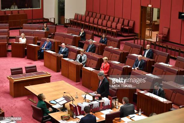 Australian senators practise social distancing in light of the COVID-19 coronavirus outbreak guidelines as they attend a scaled-down session in the...