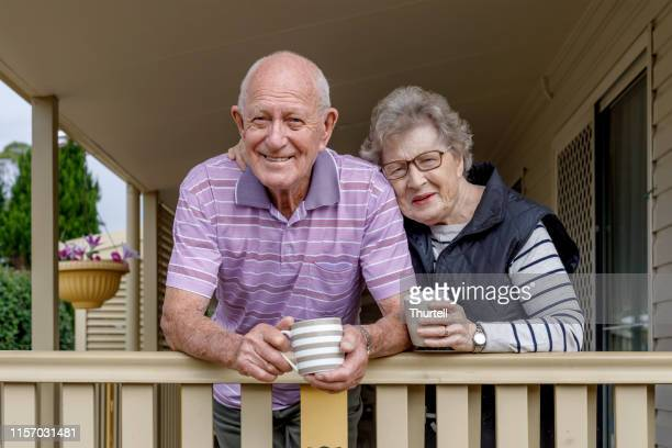 australian senior citizen couple living independently at own home - senior couple stock pictures, royalty-free photos & images