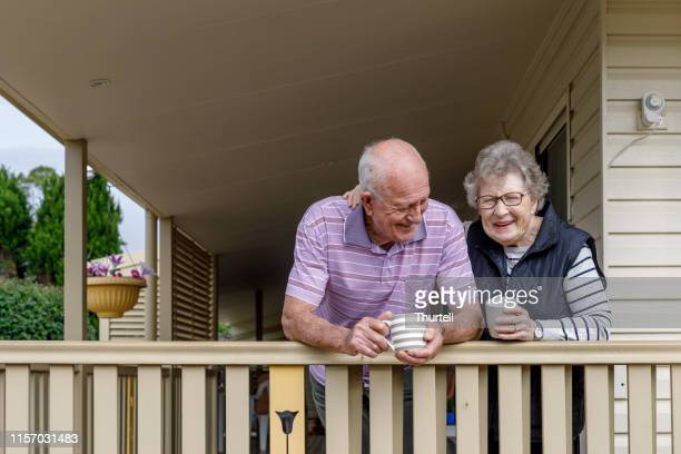 australian senior citizen couple living independently at own home - senior adult stock pictures, royalty-free photos & images