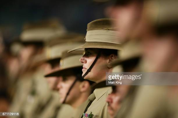 Australian service men and women take part in the ANZAC ceremony before the round nine Super Rugby match between the Waratahs and the Kings at...