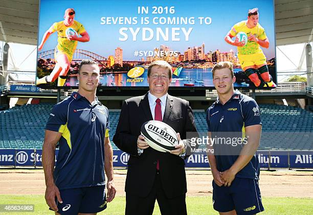 Australian Sevens players Ed Jenkins and Cameron Clark pose with NSW Deputy Premier Troy Grant during the ARU Sevens World Series announcement at...