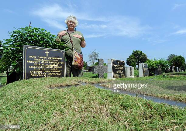 Australian Shirley Shackleton wife of late Australian journalist Greg Shackleton stands by the grave in Jakarta on July 9 where five journalists the...