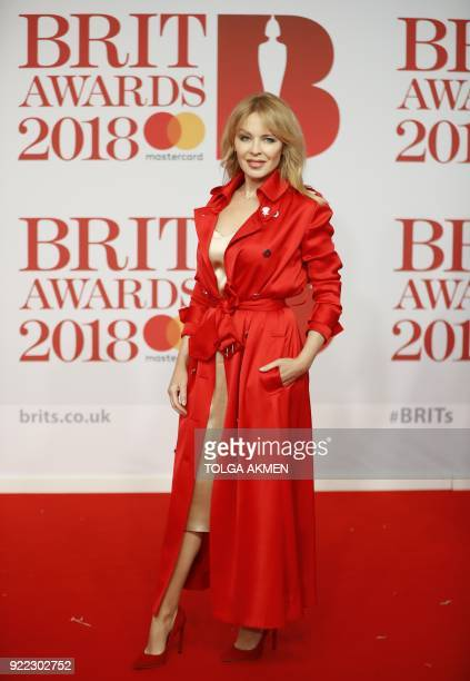 Australian singer and actress Kylie Minogue poses on the red carpet on arrival for the BRIT Awards 2018 in London on February 21 2018 / AFP PHOTO /...