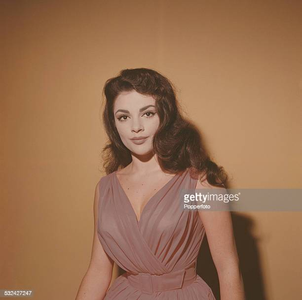 Australian singer and actress Patsy Ann Noble posed wearing a dark pink dress in 1963