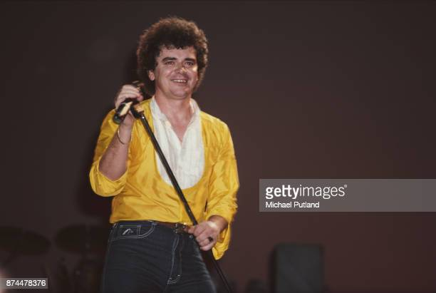 Australian singer and musician Russell Hitchcock of soft rock duo Air Supply on stage September 1983