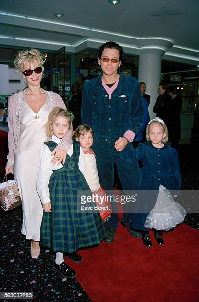 Australian singer and songwriter Michael Hutchence and British television presenter Paula Yates with two of Yates' daughters Peaches Geldof and Pixie...