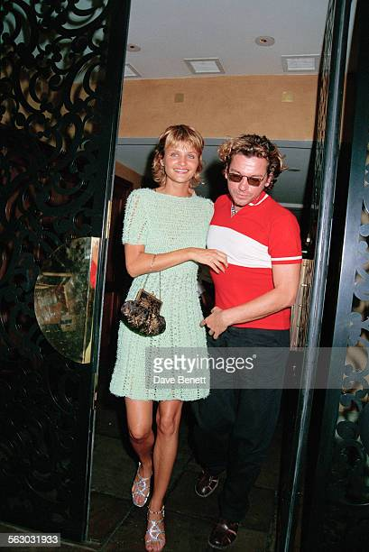 Australian singer and songwriter Michael Hutchence and Danish fashion model Helena Christensen leaving Daphne's restaurant in London 27th July 1994