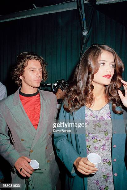 Australian singer and songwriter Michael Hutchence with Canadian model Linda Evangelista at the London Fashion Awards London 13th October 1991
