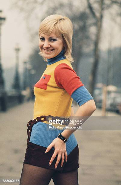 Australian singer Bev Harrell posed wearing hot pants and a multi coloured short sleeved roll neck jumper combination in London in April 1971