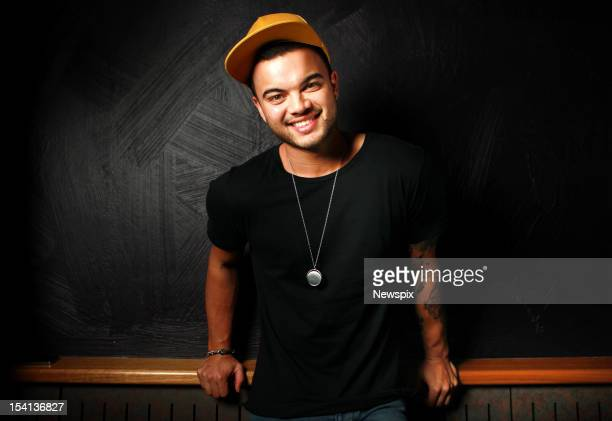 Australian singer Guy Sebastian poses during a photo shoot at the Sony Music offices on May 9 2012 in Sydney Australia