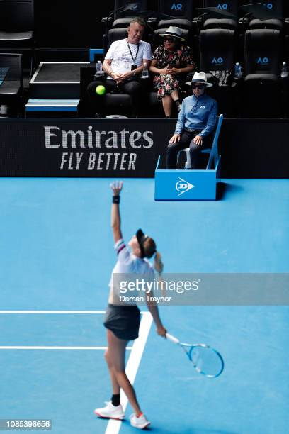 Australian singer Jimmy Barnes and wife Jane Mahoney watch on as Amanda Anisimova of the United States serves in her fourth round match against Petra...