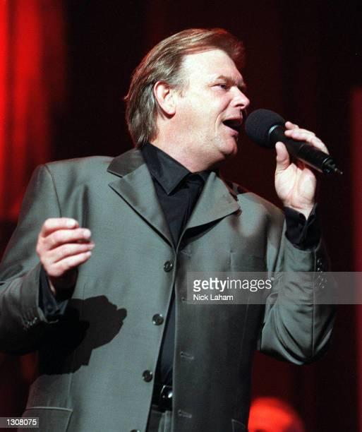 Australian singer John Farnham performs in concert November 30 2000 at the Sydney Entertainment Centre in Sydney Australia
