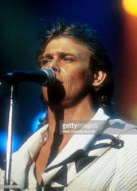 Australian singer John Farnham performs live on stage with 'Little River Band' during the Live Aid 'Oz For Africa' concert at the Sydney Sports and...