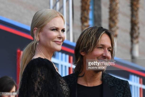 Australian singer Keith Urban and his wife Australian actress Nicole Kidman arrive for the 54th Academy of Country Music Awards on April 7 at the MGM...