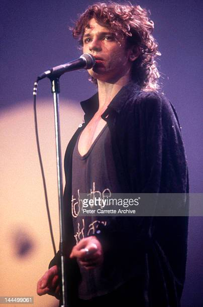 Australian singer Michael Hutchence performs live on stage with 'INXS' during the Live Aid 'Oz For Africa' concert at the Sydney Sports and...