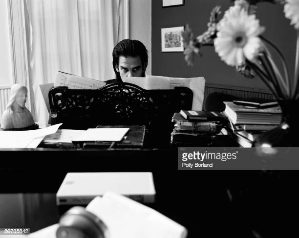 Australian singersongwriter and musician Nick Cave at the piano circa 2000 A bust of Jesus Christ sits on the piano next to him