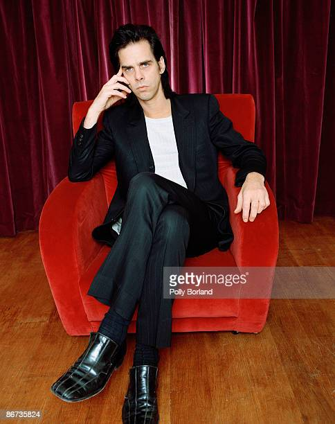 Australian singersongwriter and musician Nick Cave seated on a red velvet armchair circa 2000