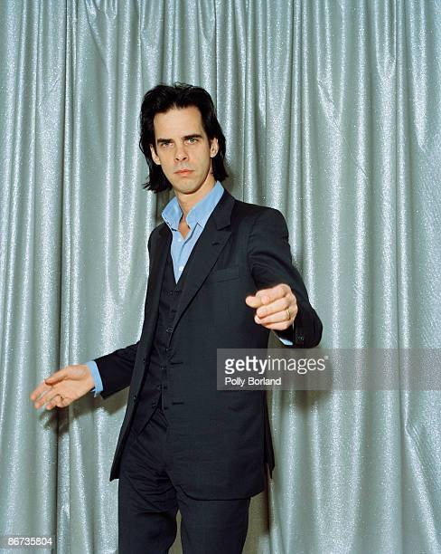 Australian singersongwriter and musician Nick Cave wearing a threepiece suit circa 2000