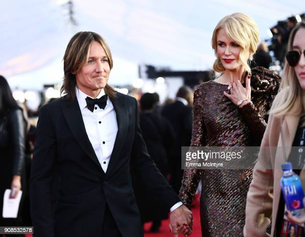 Australian singersongwriter Keith Urban and actor Nicole Kidman attend the 24th Annual Screen Actors Guild Awards at The Shrine Auditorium on January...