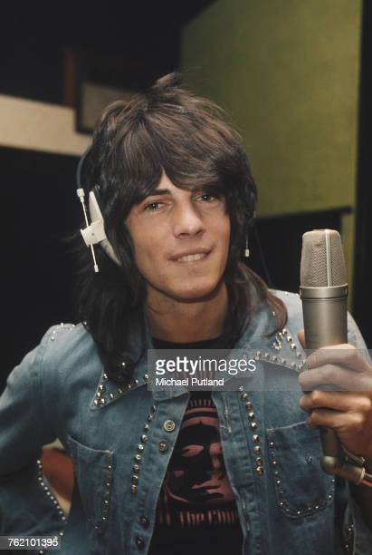 Australian singersongwriter Rick Springfield pictured wearing a studded denim jacket at a microphone in a recording studio in London in 1973