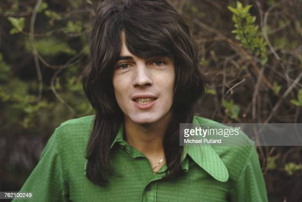 Australian singer-songwriter Rick Springfield pictured wearing a green shirt in a park in London in 1973.