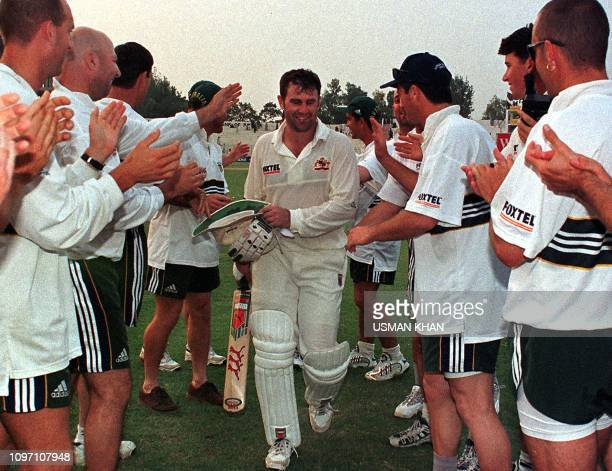 Australian skipper Mark Taylor is warmly received by his teammates after his unbeaten 334-run effort on the 2nd day of the 2nd cricket Test against...