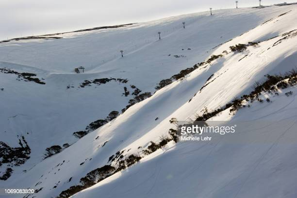 australian snowy mountains showing chair lift and ski runs - snowfield stock pictures, royalty-free photos & images