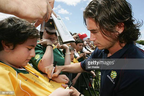 Australian Socceroo Harry Kewell signs autographs for fans November 17 2005 in Sydney Australia The team made an appearance at the Domain following...