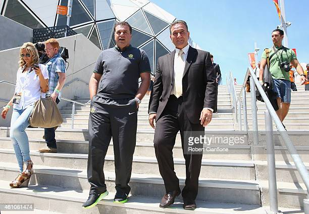 Australian Socceroos Coach Ange Postecoglou and Victorian Minister for Tourism and Major Events John Eren are seen as they leave the stadium after an...