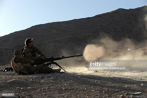 Australian soldier of Omletc company fires a 50 caliber board gun during a practice firing at the forward operation base of Mirwais in the southern...