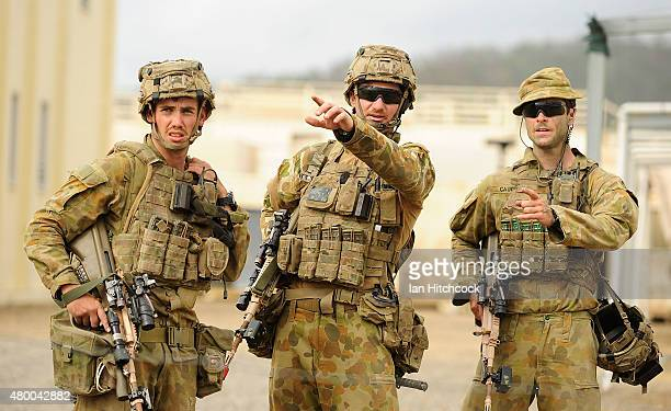 Australian soldiers from 7 Brigade discuss tactics as part of exercise Talisman Sabre on July 9 2015 in Rockhampton Australia Talisman Sabre is a...