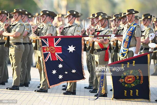 Australian soldiers from the Royal Australian Regiment conduct a salute with Battalion colours during a commemorative parade at Lavarack Barracks on...