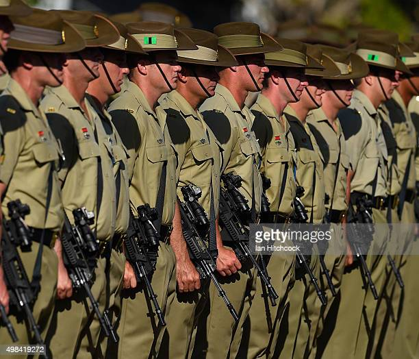 Australian soldiers from the Royal Australian Regiment look on during a parade at Lavarack Barracks on November 23 2015 in Townsville Australia This...