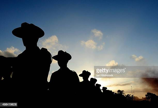 Australian soldiers from the Royal Australian Regiment march from the parade ground at the completion of a special commemorative parade at Lavarack...