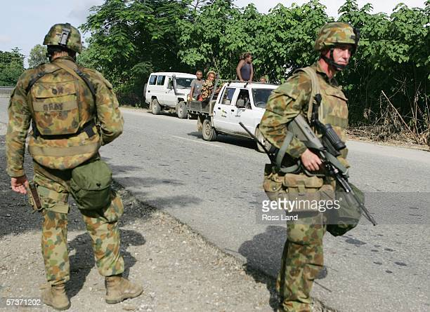 Australian soldiers man a checkpoint on the outskirts of Honiara on April 20 2006 in Honiara Solomon Islands People have been rioting in protest at...